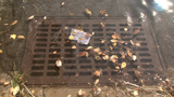 How do I report a defective sewer grate