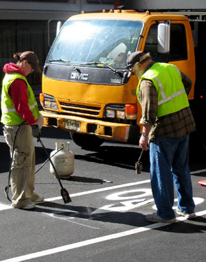 Spring's in the air and DOT is back at it, installing over 25 miles of new bike lanes this spring.