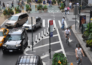 Cyclists riding along new protected paths near Herald Square in Manhattan, created as part of Green Light for Midtown.