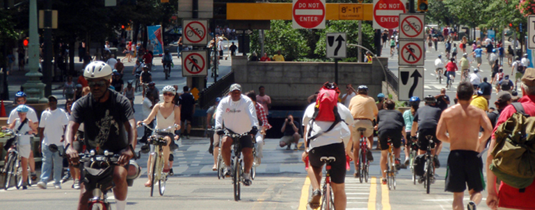 Photo of people biking and walking on the street
