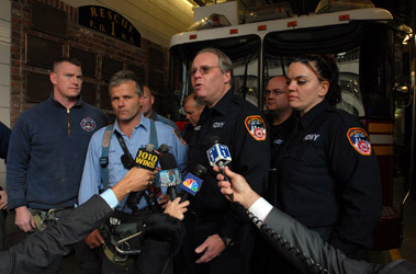 Firefighters and Rescue Paramedics Rescue Man in Manhattan