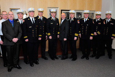 FDNY staff chiefs congratulate the new Chief of Department Edward Kilduff. (L to R) Chief Thomas Galvin, Chief Robert Byrnes, Chief Michael Gala, Chief Stephen Raynis, Chief William Seelig, Chief Kilduff, Fire Commissioner Salvatore Cassano, Chief of Operations Robert Sweeney, Chief John Sudnik, Chief Joseph Woznica and Chief Robert Maynes.