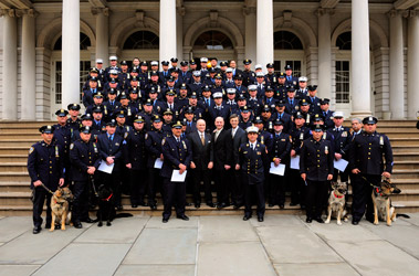 Members of the joint FDNY and NYPD Urban Search and Rescue team that traveled to Port-au-Prince, Haiti, following the devastating earthquake on Jan. 12. The team is joined on the steps of City Hall by Fire Commissioner Salvatore Cassano, Police Commissioner Ray Kelly and OEM Commissioner Joe Bruno.