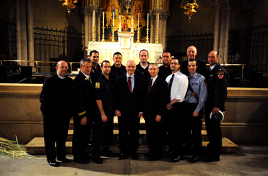 (L to R) Father James Ross Smith, DC James Hodgens, FF John Paul Rosselli, FF Mike Terriberry, FF Chris Viola, Fire Commissioner Salvatore Cassano, FF Mike Eddy, Dr. Leroy Sharer, FF Mark Browne, Ricardo Miranda, Lt. Scott Barvels, Father Stephen Gerth, BC Jerry Horton.