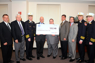 Members of Taylor & Taylor Assoc. and Fireman's Fund Insurance join FDNY members as they present the $32,000 grant. (L to R) Glenn Skrynecki, Vice President Fireman's Fund; Raymond Taylor, Chairman of the Board of Taylor & Taylor; Chief of Department Edward Kilduff; Fire Commissioner Salvatore Cassano; Terry McCormick, Territory Sales Executive at Fireman's Fund; Scott Taylor, President of Taylor & Taylor Associates; Matt Miller, President of the Association of Independent Commercial Producers; Chief of Operations Robert Sweeney; and Chief of Training Thomas Galvin.