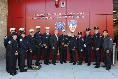 Fire Commissioner Salvatore Cassano, Chief of Department Edward Kilduff and Chief of EMS Abdo Nahmod with the members of Station 35.