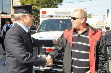 Iron Worker John Stalzer (right) is greeted by one of his rescuers, Rescue Paramedic Brian Frayne.