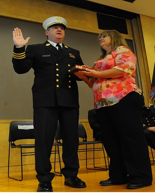 Chief Leonard takes the Oath of Office, as his wife, Patricia, holds the Bible