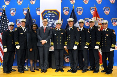 The newly appointed and promoted members. (L to R) Chief of EMS Communications Anthony Napoli; Chief of Training Stephen Raynis; Deputy Fire Commissioner, Chief Diversity and Inclusion Officer Pamela Lassiter; Fire Commissioner Daniel Nigro; Chief of Department James Leonard; Chief of Operations John Sudnik; Chief of EMS James Booth; Assistant Chief of EMS Michael Fitton; Chief of Fire Prevention Ronald Spadafora