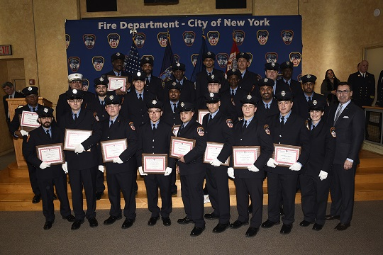 The graduating class of Fire Protection Inspectors are awarded their diplomas by Commissioner Nigro and Chief Leonard
