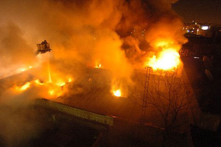 Firefighters battled a four-alarm fire in a one-story 25x100 brick commercial in East Williamsburg, Brooklyn. The building housed a kosher cold storage and ice cream packing facility. Thirty three units responded to the early morning fire that was brought under control in less than six hours. One firefighter was treated for minor injuries. The cause of the fire is under investigation. Photo by Firefighter Michael Gomez, Squad 288.
