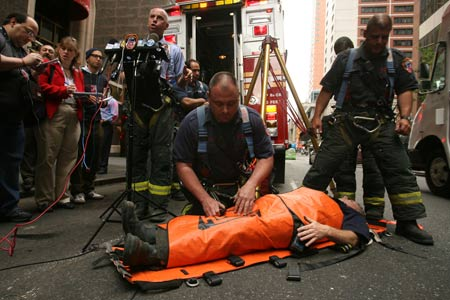 Firefighters Rescue Woman Who Fell Through Sidewalk Grating