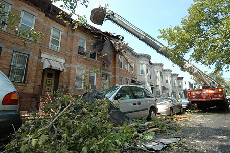 FDNY members respond to the widespread damage in Brooklyn following the storm on August 8.