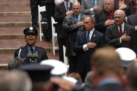 Firefighter Regina Wilson of Engine 219 sings the National Anthem at FDNY Memorial Day.