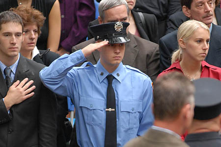 Firefighter Daniel Pujdak's (L-146) brother Matthew salutes during the 100th Annual FDNY Memorial Day ceremony. Matthew Pujdak is currently enrolled in the FDNY Academy