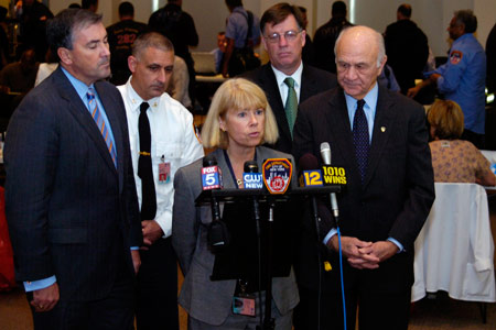 Photo of FDNY's Chief Medical Officer Kerry Kelly (center) and Fire Commissioner Nicholas Scoppetta (far right) discuss BIOPOD 2007 during a press conference at Fire Department Headquarters POD site on November 9. (L to R) New York State Deputy Secretary for Public Safety Michael Balboni, acting FDNY Counterterrorism and Emergency Preparedness Chief Michael Puzziferri and First Deputy Commissioner Frank Cruthers.