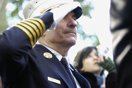 Chief of Department and military veteran Salvatore Cassano pays tribute to America's veterans during a wreath laying ceremony in Madison Square Park.