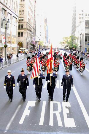 FDNY marchers make their way up Fifth Avenue during the Veteran's Day Parade.