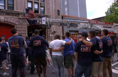 Firefighters at Ladder 146 hang bunting in honor of Firefighter Daniel F. Pujdak at their quarters in Brooklyn on June 22. Photo courtesy of Photographer Michael Schwartz, New York Daily News.