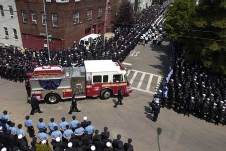 Thousands of firefighters, family members and friends lined the streets to pay their respects to Firefighter Daniel Pujdak of Ladder 146, who made the Supreme Sacrifice while operating at an all-hands fire in Brooklyn on June 21.