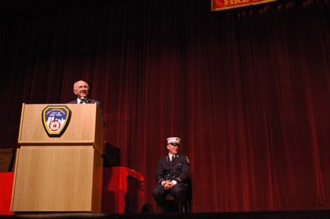 Fire Commissioner Nicholas Scoppetta addresses the crowd during Proby Graduation.