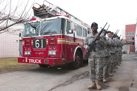 Ladder 61 was parked behind the 69th Infantry during the 21-gun salute to honor Firefighter Christian Engeldrum, who was killed in 2004 while serving with the Army National Guard in Iraq.