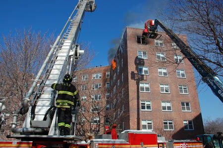 Officials study the science of wind-driven high-rise fires during experiments using a wind machine that forces 20 MPH winds into an apartment of an abandoned building.