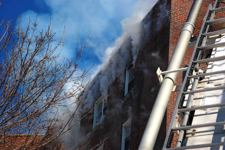 Officials study the science of wind-driven high-rise fires during experiments in an abandoned apartment building on Governors Island.