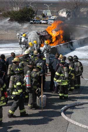 A 9,000-gallon gas truck overturned and burst into flames at around 1215 hours. Approximately 280 firefighters used a special alcohol-based foam to douse the flames. The fire was deemed under control in approximately two hours. The driver of the tanker was killed by the extreme conditions.