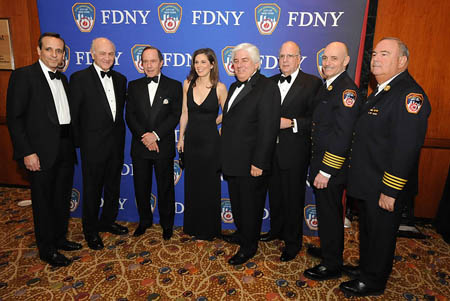 The FDNY Foundation's annual Humanitarian Awards Dinner on March 13. (L to R) FDNY Foundation Vice Chair Andrew Guarino, Fire Commissioner Nicholas Scoppetta, Honoree Mort Zuckerman, Awards Emcee Erin Burnett, Honoree Martin Sullivan, Chairman of the FDNY Foundation Steve Ruzzo, Chief of Department Salvatore Cassano and Chief of Operations Patrick McNally.