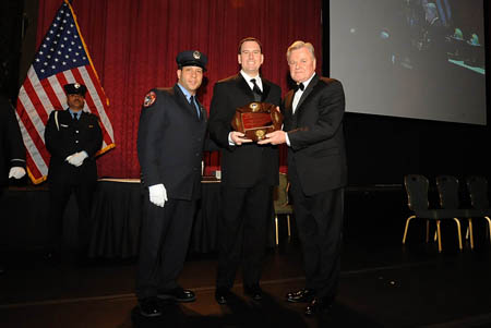 Principal James Anderson (center) accepted the Commissioner Thomas Von Essen Fire Safety Education Award on behalf of the FDNY High School for Fire and Life Safety.