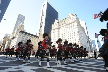 Emerald Society Pipes and Drums Band marches up Fifth Avenue during the 247th Annual St. Patrick's Day Parade.