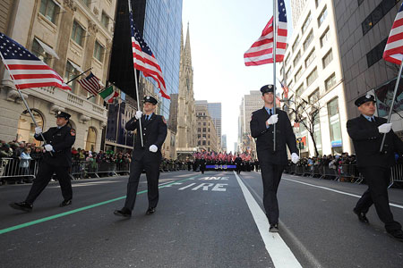 Four flags are carried up Fifth Avenue in rememberance of the four members who died in the line of duty in the last year - Lieutenants John Martinson and Joseph Graffagnino and Firefighters Daniel Pujdak and Robert Beddia. The flags were carried by firefighters from each of the men's companies.