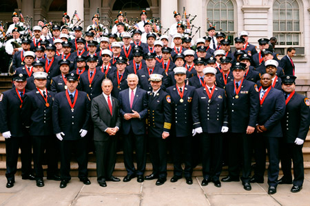 Mayor Michael Bloomberg, Fire Commissioner Nicholas Scoppetta and Chief of Department Salvatore Cassano joins the FDNY Medal Day winners on the steps of City Hall on June 4.