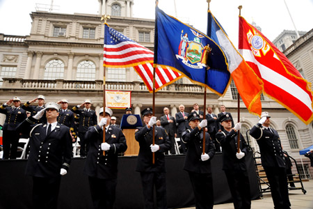 The FDNY Color Guard stands at attention as Firefighter Frank Pizarro sings the National Anthem.