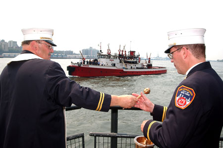 "FDNY Chaplains Monsignor John Delendick (left) and Reverend Stephen Harding blessed seven fireboats, saying, ""May you always have calm seas and fair winds."""
