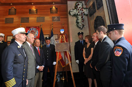 Mayor Michael Bloomberg, Fire Commissioner Nicholas Scoppetta and Chief of Department Salvatore Cassano join the Pujdak family - including his parents, Leo and Christina, and brothers, Matthew and David - as a plaque is unveiled in the Firefighter Daniel Pujdak's honor at the quarters of Engine 229/Ladder 146 in Brooklyn.