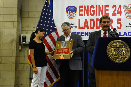Linda Graffagnino, Lt. Joseph Graffagnino's wife, receives a plaque and Medal of Supreme Sacrifice from the Uniformed Fire Officers Association. Firefighter Robert Beddia's family received a similar plaque and medal from the Uniformed Firefighters Association.