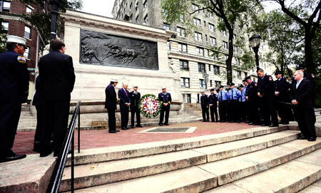 Fire Commissioner Nicholas Scoppetta, Chief of Department Salvatore Cassano, Chief of Operations Patrick McNally and FDNY Chaplain Reverend Stephen Harding place a wreath at the Firefighters' Memorial in upper Manhattan on the morning of Sept. 11.