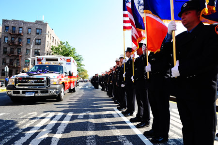 FDNY EMT Jason Ruiz's ambulance was draped with purple and black bunting to honor the hero at his funeral on Sept. 18.