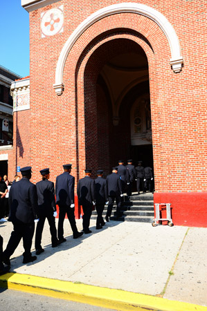 FDNY EMS members file into St. Michael's Roman Catholic Church in Brooklyn.