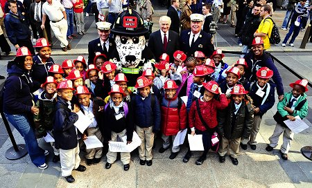 Second graders from Achievement First Crown Heights Elementary joined Fire Commissioner Nicholas Scoppetta, Chief of Department Salvatore Cassano and Chief of Operations Patrick McNally kick off Fire Prevention Week 2008 in Rockefeller Center.