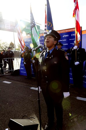 Firefighter Regina Wilson of Engine 219 sings the National Anthem at the start of the 2008 ING New York City Marathon on Staten Island.