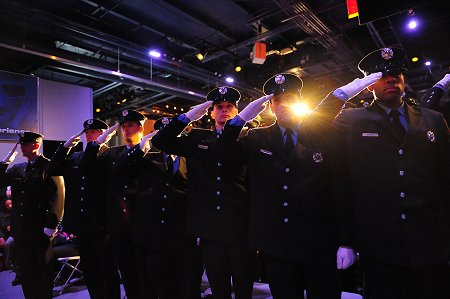 The firefighters graduated during a ceremony aboard the U.S.S. Intrepid.