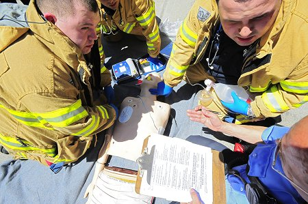 EMTs treat a simulated victim who went in to cardiac arrest during the 2009 EMS Competition.