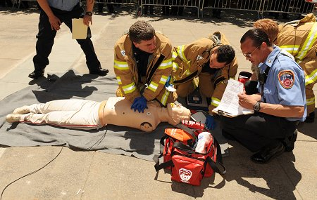 Members perform CPR on a simulated patient that has gone into cardiac arrest.
