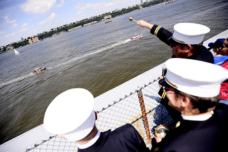 FDNY Chaplains Monsignor John Delendick and Reverend Stephen Harding bless the FDNY's Marine Fleet from atop the flight deck of the USS Intrepid.