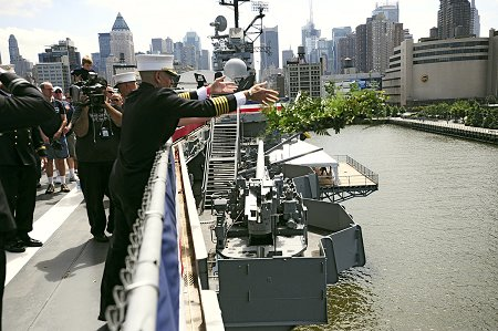 Chief of Department Salvatore Cassano drops a ceremonial wreath into the Hudson River during the Blessing of the Fleet ceremony.