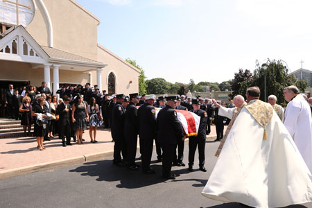 FF Paul Warhola's family, including his wife, Arleen, and children, Paul and Tiana, attended the funeral service at St. John the Evangelist RC Church in Center Moriches, Long Island.