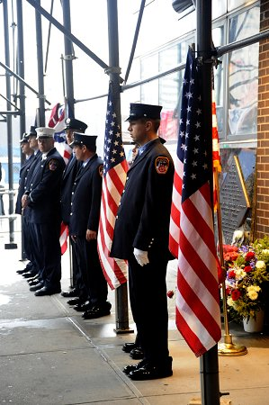 Firefighters stand in front of the Sept. 11 memorial, outside the quarters of Engine 10/Ladder 10, on the eighth anniversary of the attacks.